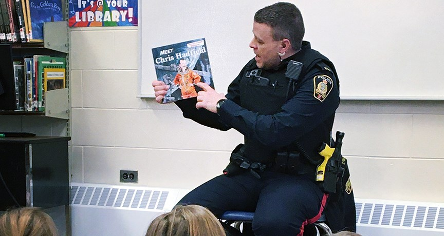 police officer reading