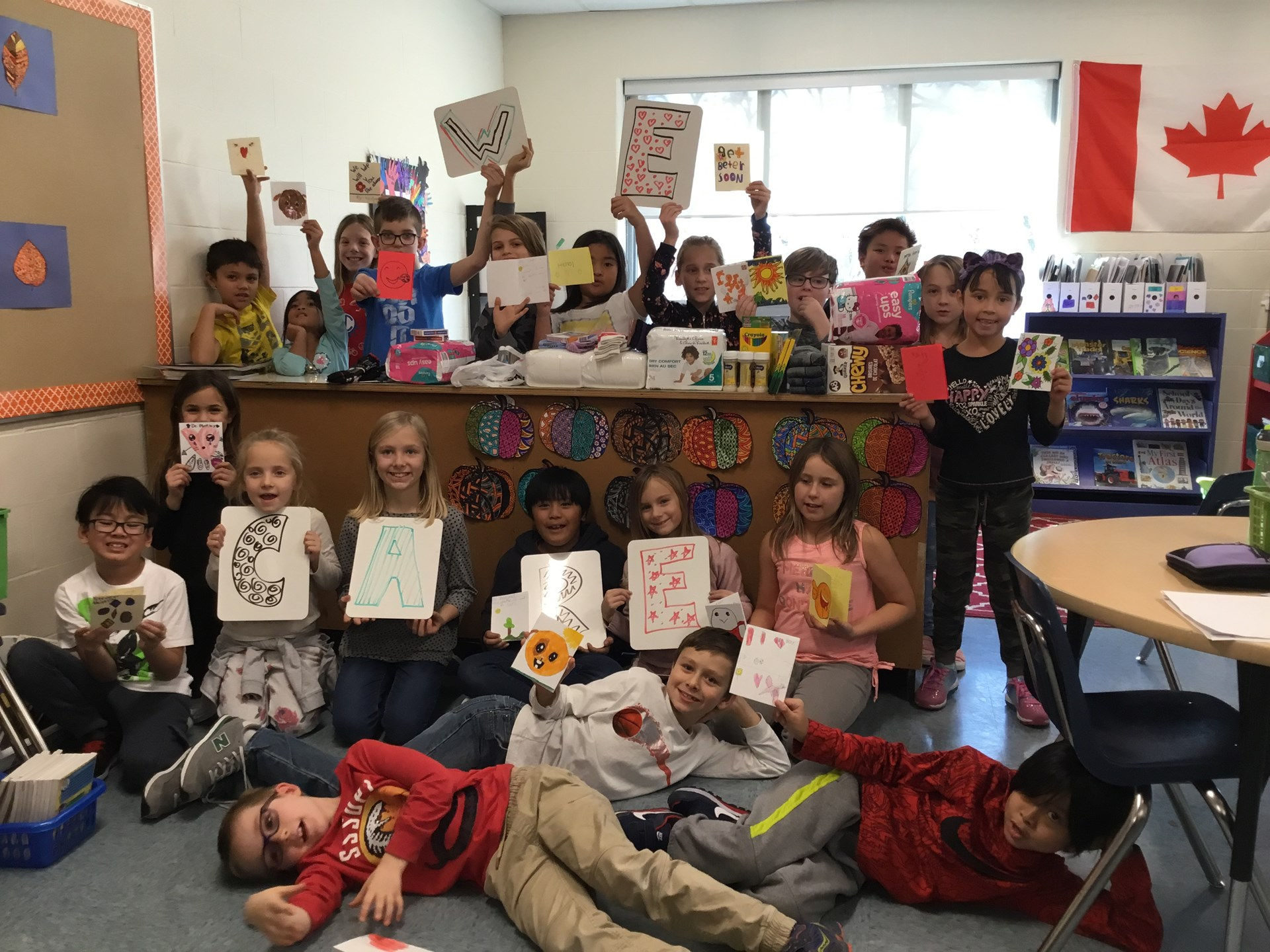 "Mme Lisa and Mme McEachern's class, ""Making a difference in our community"""